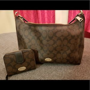 | Coach Signature East/West Celeste | EUC |